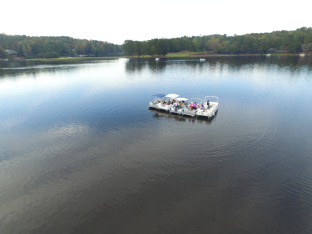 A cluster of boats float on Lake Trace