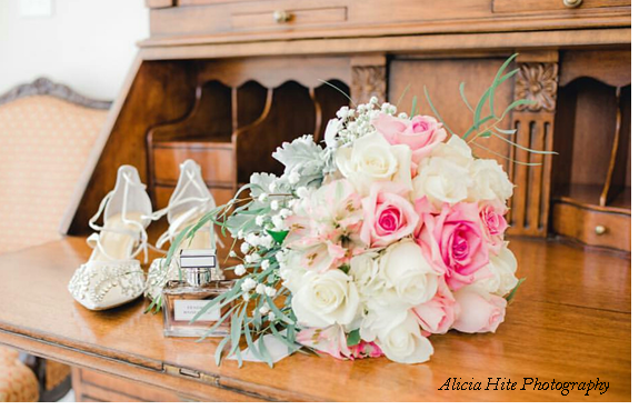 A bouquet of flowers rests on a dresser